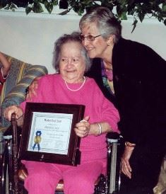 Past Chair Shirley Mosczynski presenting Philomene Fanny Yacio with her certificate in August 2004