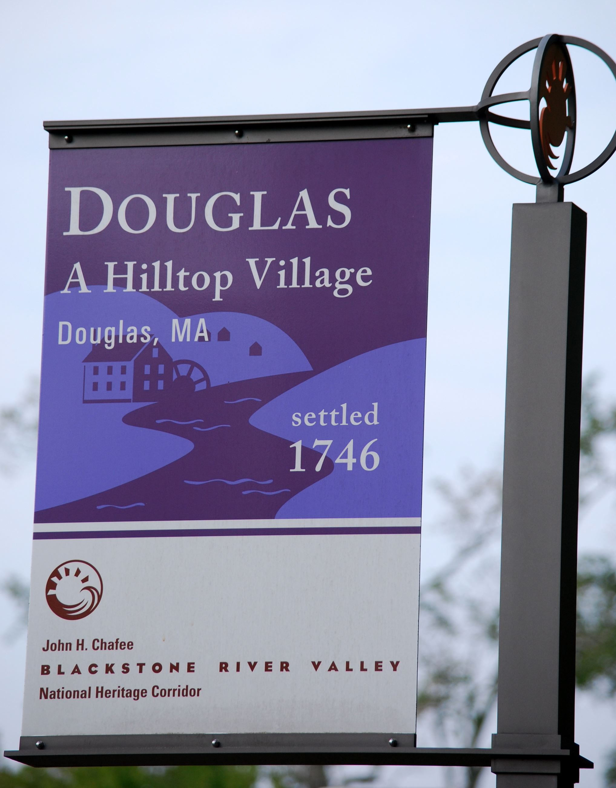 Street Flag on post, with text Douglas Hilltop Village  settled 1746
